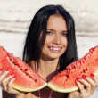 Beautiful girl eats water-melon — Stock Photo #47360709