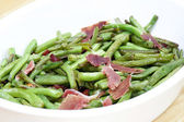 Fried green beans with ham — Stock Photo