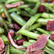 Fried green beans with ham - Stock Photo