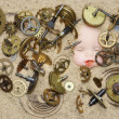 Stock Photo: Clockwork mechanism on sand