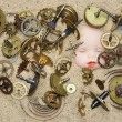 Clockwork mechanism on the sand — Stock Photo