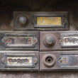 Old and damaged doorbells - buttom — Stock Photo