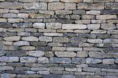 Fundo parede de pedra seca — Foto Stock