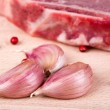 Garlic, steak and pink peppercorns — Stock Photo