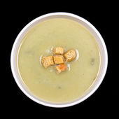 Leek and potato soup on black — Stock Photo