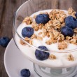 Yogurt with granola and blueberries. — Stock Photo #31405645