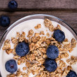 Yogurt with granola and blueberries. — Stock Photo #31405679