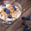 Yogurt with granola and blueberries. — Stock Photo #31406881