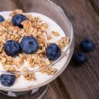 Yogurt with granola and blueberries. — Stock Photo