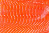 Smoked salmon background — Stock Photo