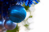 Blue baubles and bokeh — Stock Photo