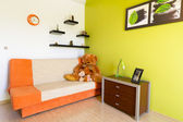 White and green bedroom with orange sofa — Stock Photo