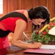 Witness signing marriage form — Stock Photo #12255039