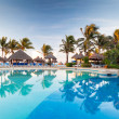 Tropical swimming pool at sunrise — Stock Photo #12255223