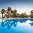 Tropical swimming pool at sunrise — Stock Photo #12255226