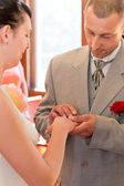 Married couple putting wedding rings — Stock Photo