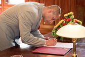Groom signing marriage form — Stock Photo