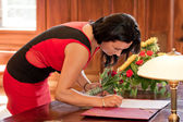 Witness signing marriage form — Stock Photo