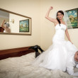 Bride and groom on the hotel bed — Stock Photo #12586419