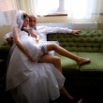 Sexy bride sitting on groom — Stock Photo #12586488