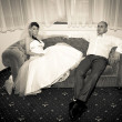 Bride with groom on the sofa — Stock Photo