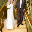 Bride and groom on restaurant stairs — Stock Photo #12586718