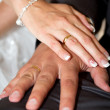 Married couple holding hands together - Stock Photo
