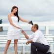 Bride pushing groom to the marriage — Stock Photo #12587254