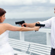 Stock Photo: Bride and groom trying to kill each other