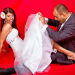 Bride and groom having fun — Stock Photo #12590813