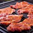 Steak meat on barbecue — Stock Photo #12593720