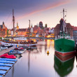 Old town of Gdansk at Motlawa river at sunset — Stock Photo #12595845