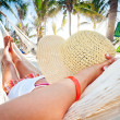 Woman relaxing in the hammock — Stock Photo #12598889
