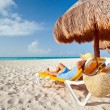 Relaxation under parasol at Caribbean Sea — Stock Photo #12599064