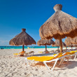 Holidays under parasol on Caribbean beach — Stock Photo