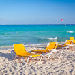 Stock Photo: Empty deck chairs on the Caribbean beach