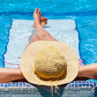 Relaxation on the swimming pool bed — Stock Photo #12599534