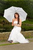 Portrait of beautiful bride with umbrella — Stock Photo