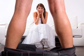 Bride shocked at the groom striptease — Stock Photo