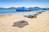 Blue parasols at Aegean Sea — Stock Photo