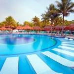 Morning at tropical swimming pool — Stock Photo #13547706