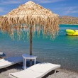 Deckchair under parasol at Aegean Sea — Stock Photo