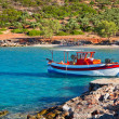Fishing boat at idyllic beach on Crete — Stock Photo