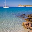Stock Photo: White yacht on the idyllic beach lagoon of Crete