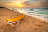 Yellow deckchair on the Caribbean Sea — Stock Photo