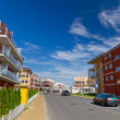Street with new apartments — Stock Photo #13551617
