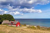 Red Swedish cottage house at Baltic Sea — Stock Photo