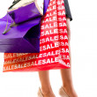 Female in high heels with shopping bags — Stock Photo