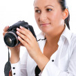 Female photographer holding camera — Stock Photo