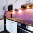 White and purple kitchen interior — Stock Photo #13974747